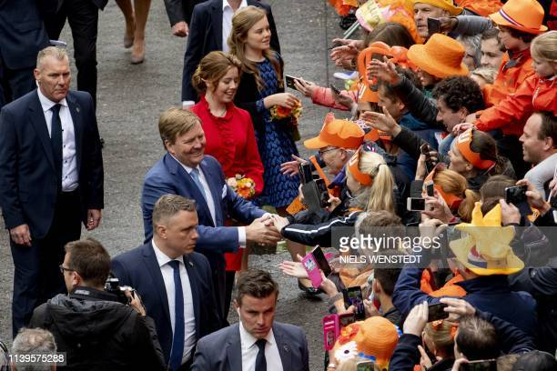 Dutch King WillemAlexander Princess Alexia and Princess Ariane shake hands in Amersfoort on Kings Day on April 27 2019 The king celebrates his...