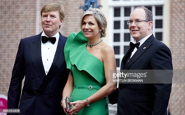 Dutch King WillemAlexander Queen Maxima and Prince Albert II of Monaco pose for a photograph prior to a dinner at the Loo Palace in Apeldoorn the...