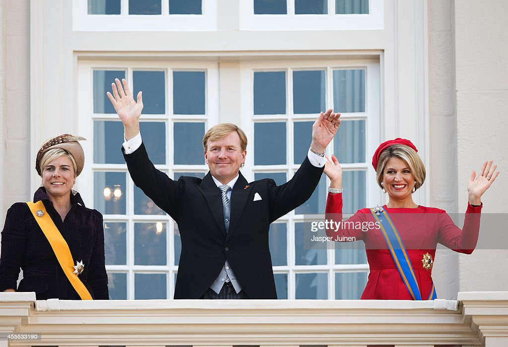 Dutch King Willem-Alexander (2nd R), Queen Maxima (R) and Princess Laurentien (L) of wave from the Noordeinde palace balcony on September 16, 2014 in The Hague, Netherlands. The Dutch King officially opened the parliamentary year by reading a speech outlining the government plans for the year ahead.