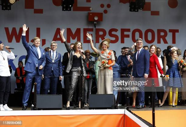 Dutch king Willem-Alexander, Queen Maxima and singer Maria Fuselier celebrate during the closing of Kings Day in Amersfoort on April 27 where the...