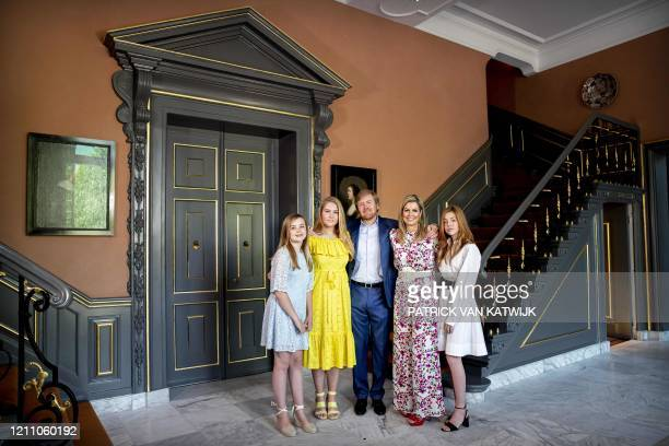 Dutch King Willem-Alexander, Queen Maxima and their daughters, princesses Amalia, Alexia and Ariane pose as they celebrate King's Day in Huis ten...