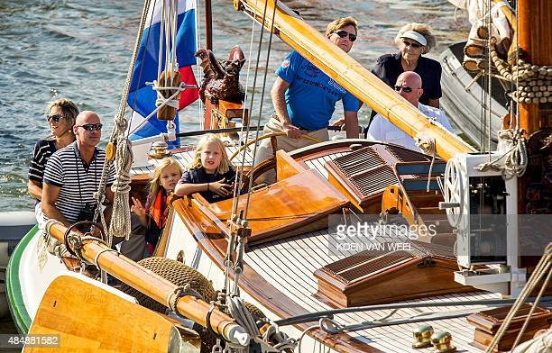 Dutch King WillemAlexander Queen Maxima and their three daughters Amalia Alexia and Ariane sail along with Princess Beatrix on their private ship The...