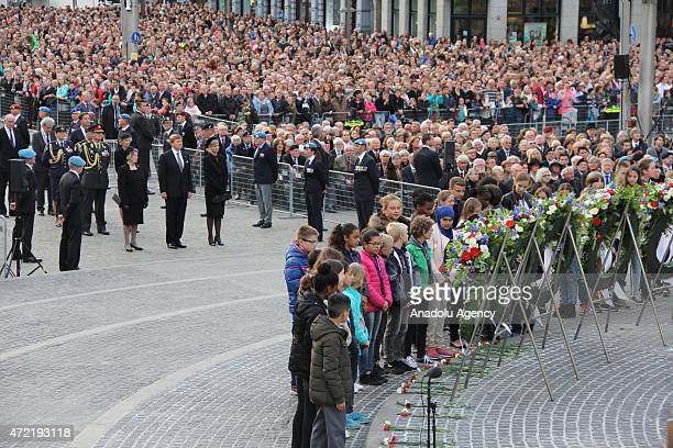 "Dutch King Willem-Alexander , Queen Maxima stand in one minute's silence during the annual ""National Commemoration"" ceremony held for the victims who..."