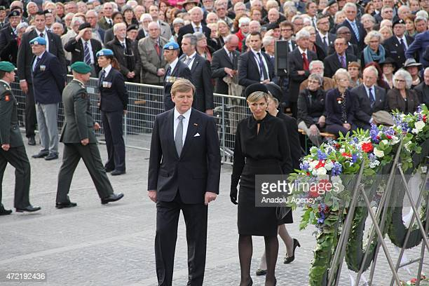 "Dutch King Willem-Alexander , Queen Maxima walk during the annual ""National Commemoration"" ceremony held for the victims who died during the German..."