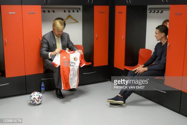Dutch King Willem-Alexander receives a shirt with the signatures from the players of Feyenoord Rotterdam captain Steven Berghuis during a working...