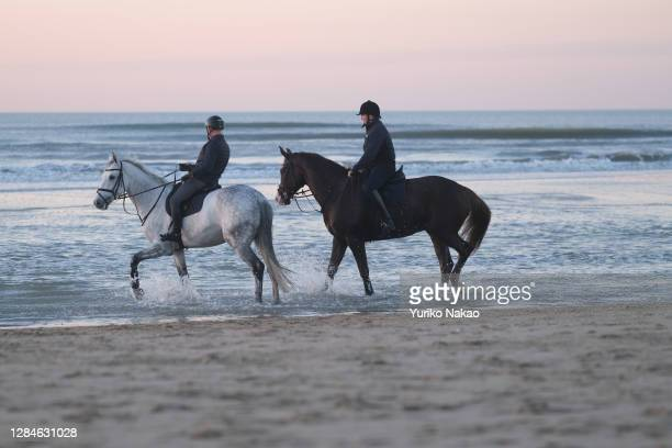 Dutch King Willem-Alexander rides a horse along the sea shore on November 6, 2020 in Katwijk, Netherlands.