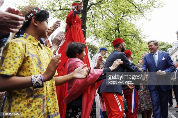 Dutch King WillemAlexander shakes hands in Amersfoort on Kings Day on April 27 2019 The king celebrates his birthday in the city in central...