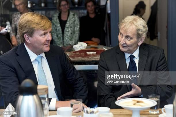 """Dutch King Willem-Alexander sits with Amsterdam's mayor Eberhard van der Laan, as he visits the Amsterdam neighborhood the """"Jordaan"""" in Amsterdam,..."""