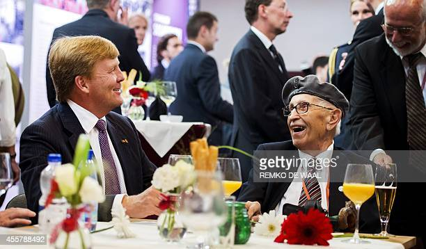 Dutch King WillemAlexander speaks with a veteran during the commemoration of the Polish contribution to Operation Market Garden in Driel on September...