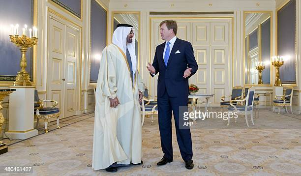 Dutch King WillemAlexander speaks with Abu Dhabi Crown Prince Sheikh Mohammed bin Zayed alNahyan during a bilateral meeting in The Hague on March 25...