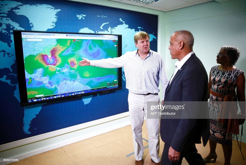 Dutch King Willem-Alexander (L) visits a meteorological institute on September 10, 2017 in Willemstad, on the Dutch island of Curacao, off of Venezuela, that was hit by Hurricane Irma. Dutch King Willem-Alexander arrived on the Caribbean island of Curacao with Interior Minister to view first-hand the aid and rescue operation for nearby Saint Martin (Sint Maarten), ANP news agency said. / AFP PHOTO / ANP / Vincent Jannink / Netherlands OUT - Belgium OUT