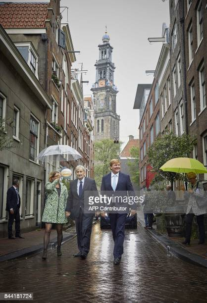 "Dutch King Willem-Alexander visits the Amsterdam neighborhood the ""Jordaan"" with the mayor Eberhard van der Laan in Amsterdam, the Netherlands, on..."