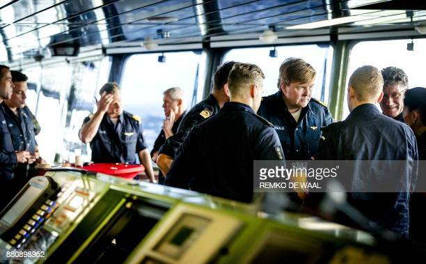 Dutch King WillemAlexander visits the multifunction support ship HNLMS Karel Doorman in the Navy harbour of Den Helder on November 28 2017 after the...