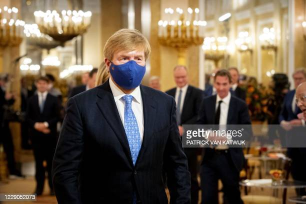 Dutch King Willem-Alexander wearing a face mask hosts a small group involved in the pact Towards a debt-free Netherlands at Noordeinde Palace in The...