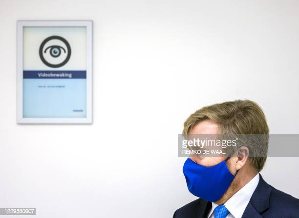 Dutch King Willem-Alexander, wearing a face mask, visits the Erasmus MC Emergency Department, to be informed about the situation in hospitals during...
