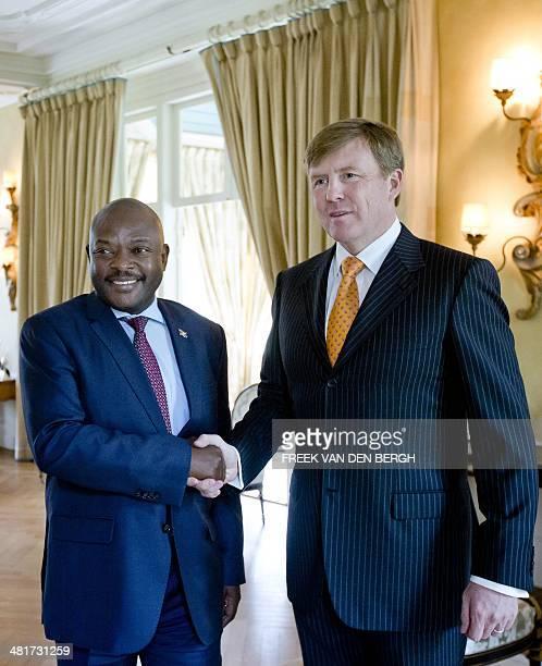"Dutch King Willem-Alexander welcomes Burundian President Pierre Nkurunziza during an audience at the King's residence ""De Eikenhorst"" in Wassenaar,..."