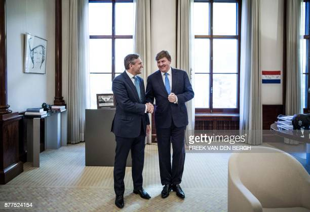 Dutch King WillemAlexander welcomes CDA party leader Sybrand Buma at the Noordeinde Palace in The Hague on November 22 2017 After the installation of...