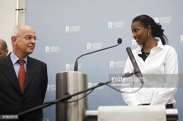 Dutch Liberal MP and former Somalian refugee Ayaan Hirsi Ali smiles at Dutch Finance Minister Gerrit Zalm at the press conference to announce her...