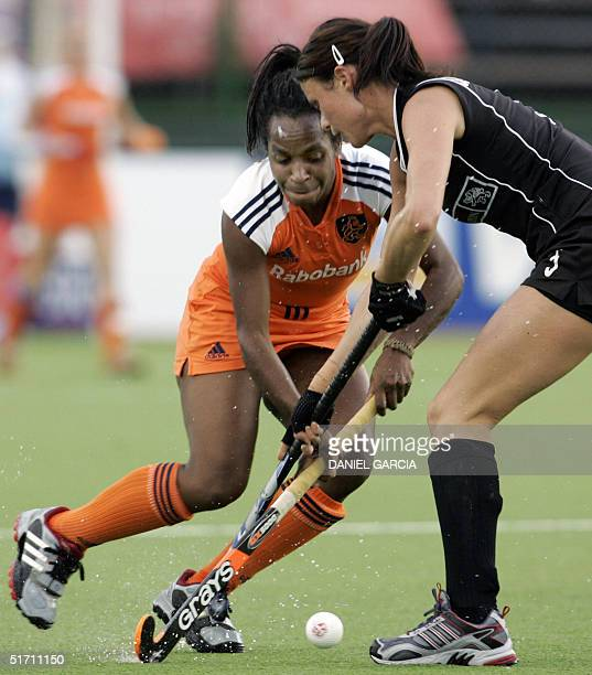 Dutch Maartje Scheepstra tries to get past Karlie Maloney of New Zeland during their field hockey match for the Champions Trophy in Rosario Argentina...