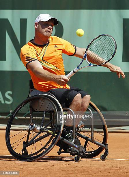 Dutch Maikel Scheffers returns the ball to France's Nicolas Peifer during their men's Wheelchair single final in the French Open tennis championship...