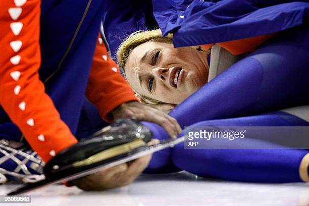 Dutch Marianne Timmer grimaces after she fell during her 500 meter race at the ISU World Cup speedskating in Heerenveen on November 13 2009 Dutch...
