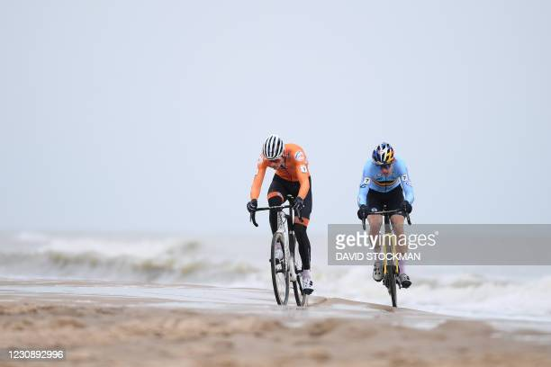 Dutch Mathieu Van Der Poel and Belgian Wout Van Aert compete at the start of the men's elite race at the UCI Cyclocross World Championships, in...
