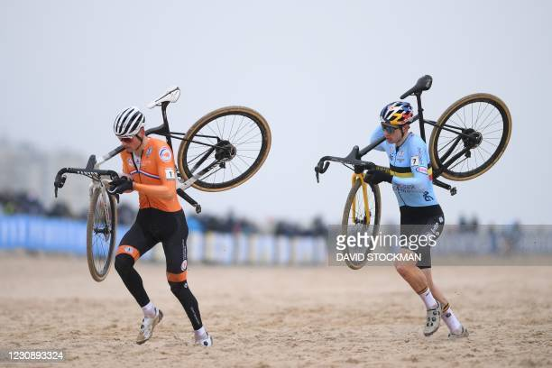 Dutch Mathieu Van Der Poel and Belgian Wout Van Aert run at the start of the men's elite race at the UCI Cyclocross World Championships, in Oostende...