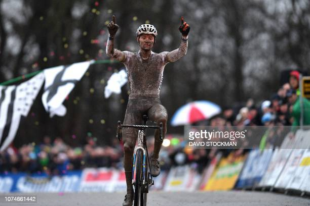 Dutch Mathieu Van Der Poel celebrates as he crosses the finish line to win the men elite race of the World Cup cyclocross in Namur 6th stage of the...