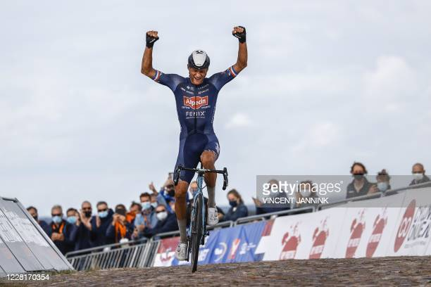 Dutch Mathieu van der Poel celebrates as he crosses the finish line during the Dutch Cycling Championships in Wijster on August 23 2020 / Netherlands...