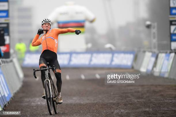 Dutch Mathieu Van Der Poel celebrates as he crosses the finish line to win the men's elite race at the UCI Cyclocross World Championships, in...