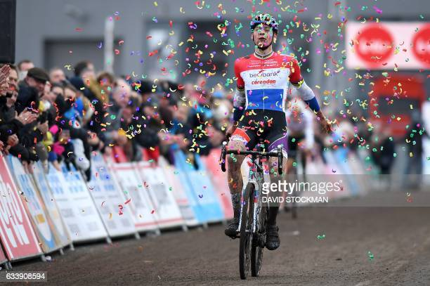 TOPSHOT Dutch Mathieu Van Der Poel celebrates as he crosses the finish line to win the 7th stage of the Superprestige cyclocross cycling competition...
