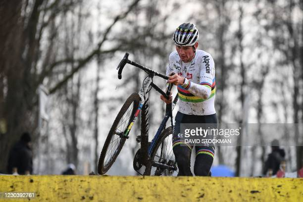 Dutch Mathieu Van Der Poel competes as he crosses the finish line to win the men's elite race of the Gullegem Cyclocross cycling event, in Gullegem,...