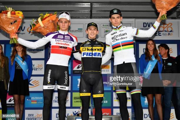 Dutch Mathieu Van Der Poel Dutch Lars Van Der Haar and Belgian world champion Wout Van Aert celebrate on the podium at the end of the men's elite...