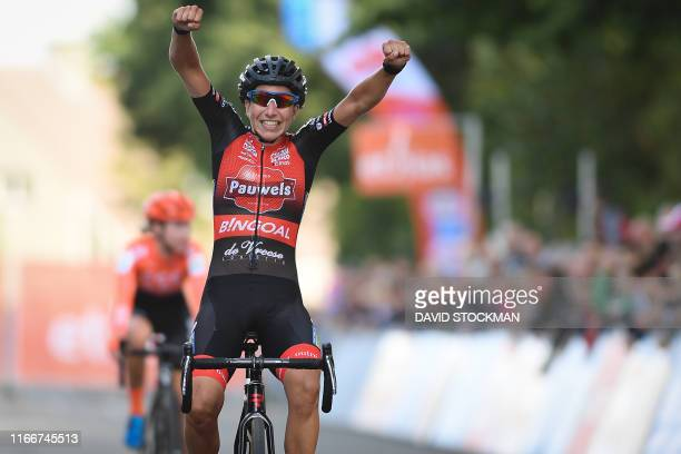 Dutch Maud Kaptheijns celebrates as she crosses the finish line to win the GP Eeklo the first race of the Ethias Cross Trophy in the women elite...