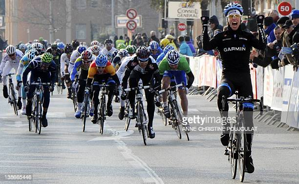 Dutch Michel Kreder celebrates as he crosses the finish line at the end of the first stage of the Tour Mediterraneen cycling race on February 10 2012...