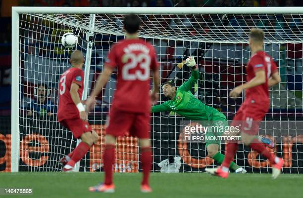 Dutch midfielder Rafael van der Vaart scores past Portuguese goalkeeper Rui Patricio during the Euro 2012 football championships match Portugal vs....