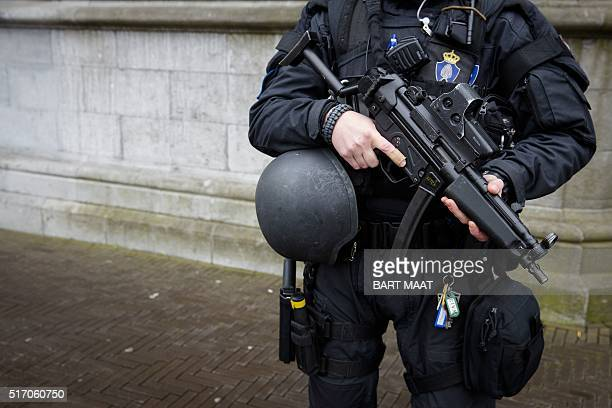 A Dutch military police officer stands guard at the Binnenhof during a patrol in The Hague on March 23 2016 as security measures were reinforced in...