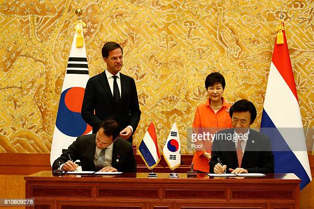 Dutch Minister of Agriculture Martijn van Dam and South Korean foreign minister Yun ByungSe sign a Memorandum Of Understanding on the Employment and...