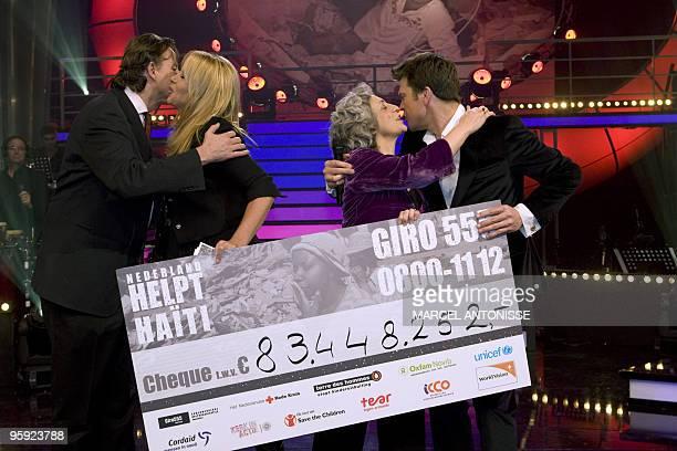 Dutch Minister of Development Aid Bert Koenders kisses TVpresenter Linda de Mol as TV presenter Beau van Erven Dorens is kissed by Fatimah Karimi...