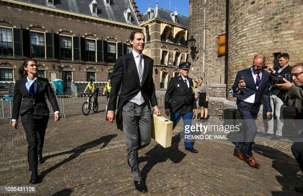 Dutch Minister of Finance Wopke Hoekstra arrive at the Binnenhof in The Hague on September 18 carrying a special case containing part of the 2018...