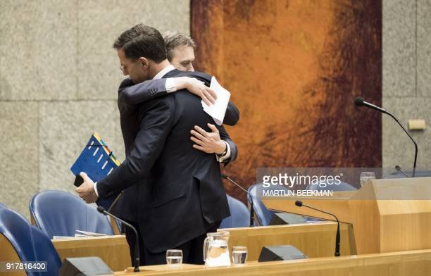 Dutch Minister of Foreign Affairs Halbe Zijlstra hugs prime minister Mark Rutte after he announced his resignation in the Dutch parliament De Tweede...