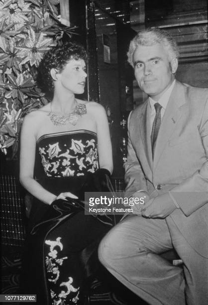 Dutch model and actress Sylvia Kristel with French film director Just Jaeckin at a soirée at Regine's nightclub in Paris France in honour of Kristel...