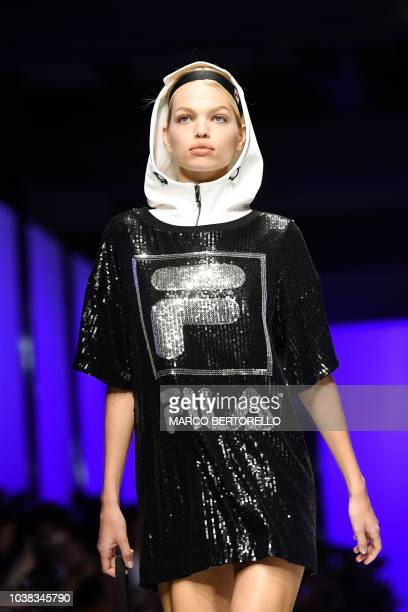 Dutch model Daphne Groeneveld presents a creation during the Fila fashion show as part of the Women's Spring/Summer 2019 fashion week in Milan on...