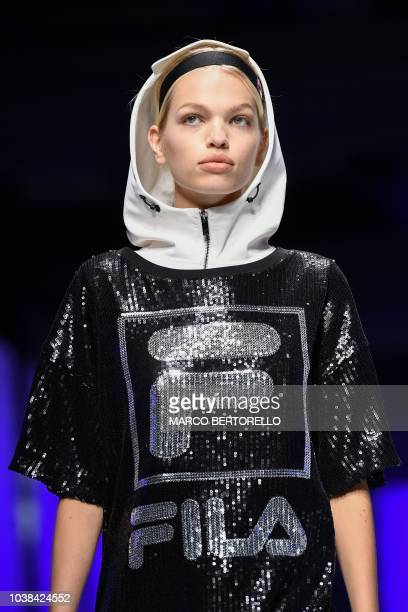 Dutch model Daphne Groeneveld presents a creation during the Fila fashion show, as part of the Women's Spring/Summer 2019 fashion week in Milan, on...