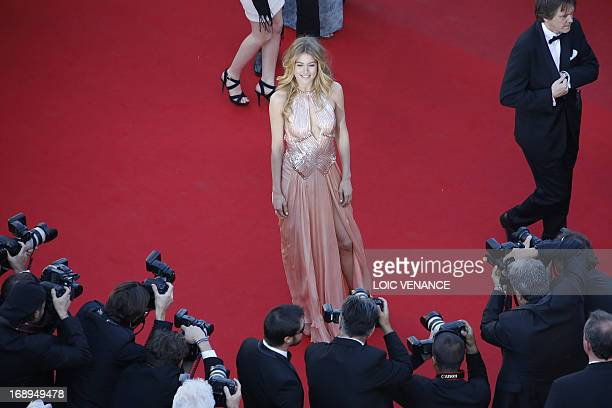 Dutch model Doutzen Kroes poses on May 17 2013 as she arrives for the screening of the film 'The Past' presented in Competition at the 66th edition...