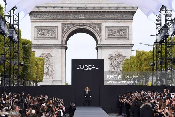 TOPSHOT Dutch model Doutzen Kroes takes part in the L'Oreal fashion show on the sidelines of the Paris Fashion Week on a catwalk set up on the...