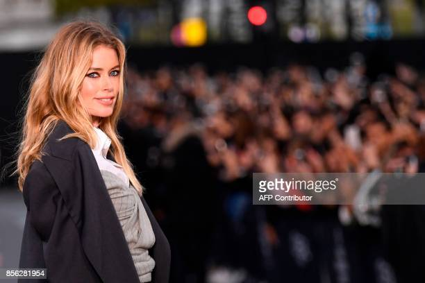 Dutch model Doutzen Kroes takes part in the L'Oreal fashion show on the sidelines of the Paris Fashion Week on a catwalk set up on the ChampsElysees...