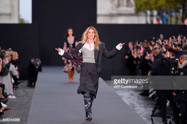 TOPSHOT Dutch model Doutzen Kroes takes part in the L'Oreal fashion show which theme is Paris on the sidelines of the Paris Fashion Week on a catwalk...