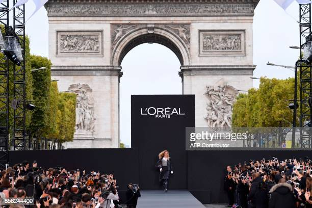 Dutch model Doutzen Kroes takes part in the L'Oreal fashion show which theme is Paris on the sidelines of the Paris Fashion Week on a catwalk set up...
