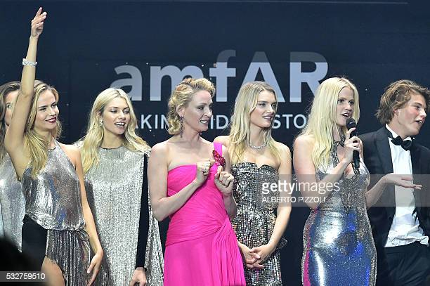 Dutch model Lara Stone talks on stage next to Russian model Natasha Poly Australian model Jessica Hart US actress Uma Thurman British model Lily...